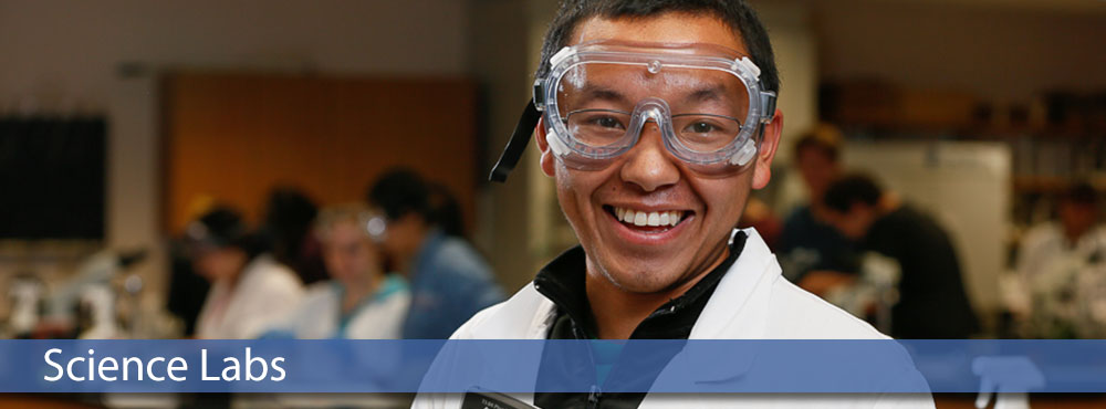 MSC student wearing goggles and lab coat in science lab