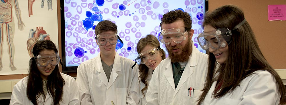 Students working in science lab with instructor
